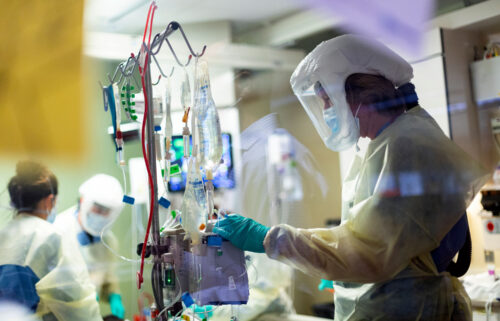 Jack Kingsley R.N. attends to a Covid-19 patient in the Medical Intensive care unit (MICU) at St. Luke's Boise Medical Center in Boise