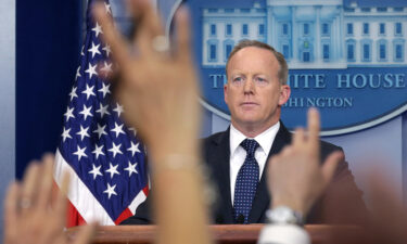 Sean Spicer and Russ Vought have sued the Biden administration over their threatened removal from the Naval Academy Board of Visitors.