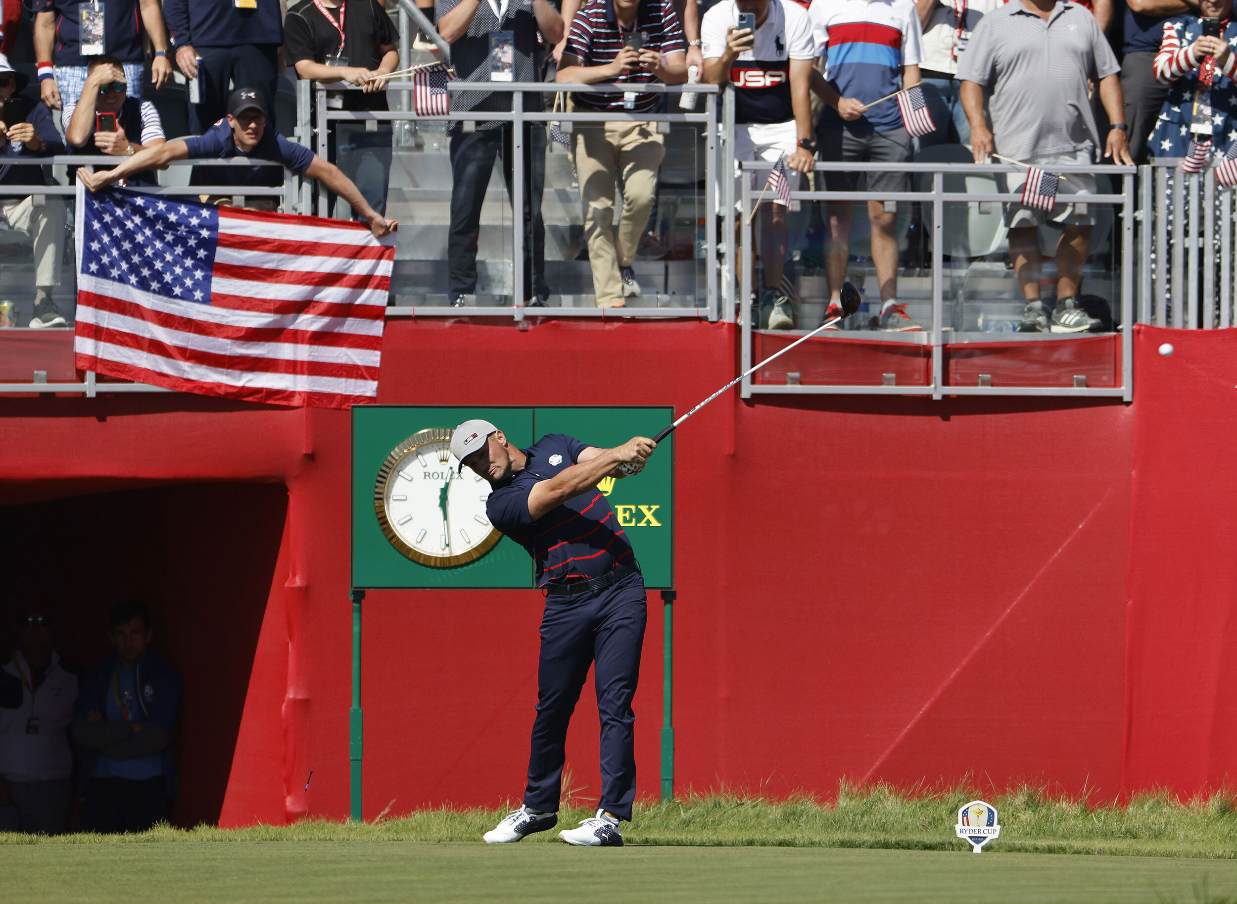 <i>Erik S Lesser/EPA-EFE/Shutterstock</i><br/>Bryson Dechambeau hits his tee shot on the first hole during the Fourball matches.