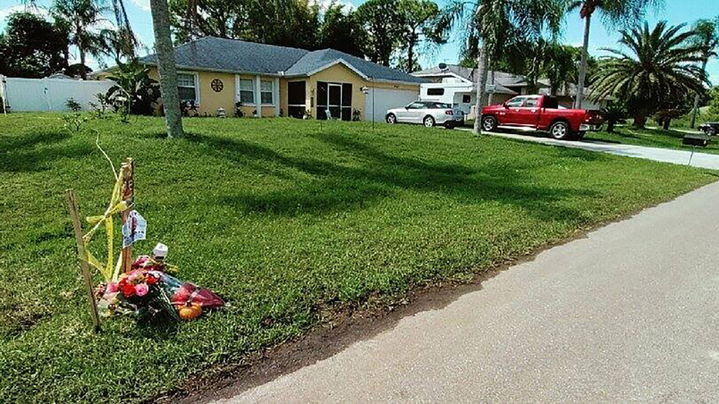 <i>Daniel Shepherd/CNN</i><br/>A small memorial of flowers outside the Laundrie home in North Port
