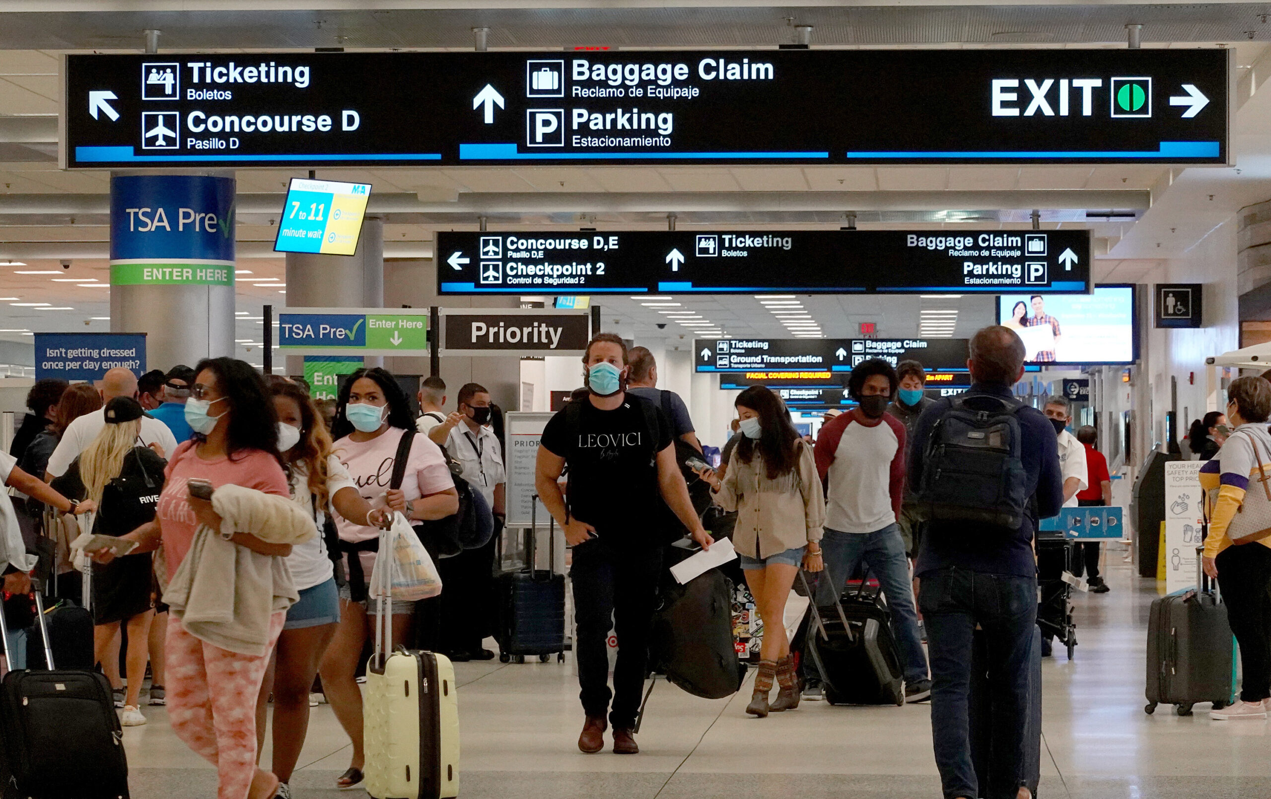 <i>Joe Raedle/Getty Images</i><br/>Travelers make their way through the Miami International Airport on September 3 in Miami