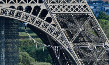 Nathan Paulin performs on a 70-meter-high slackline between the Eiffel Tower and the Chaillot Theater on September 18.