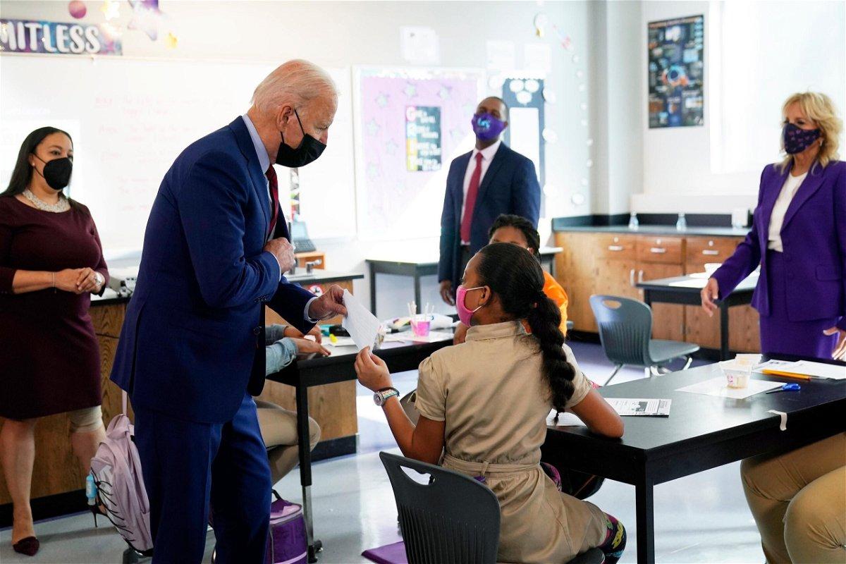 <i>Manuel Balce Ceneta/AP</i><br/>President Joe Biden and first lady Jill Biden tour Brookland Middle School