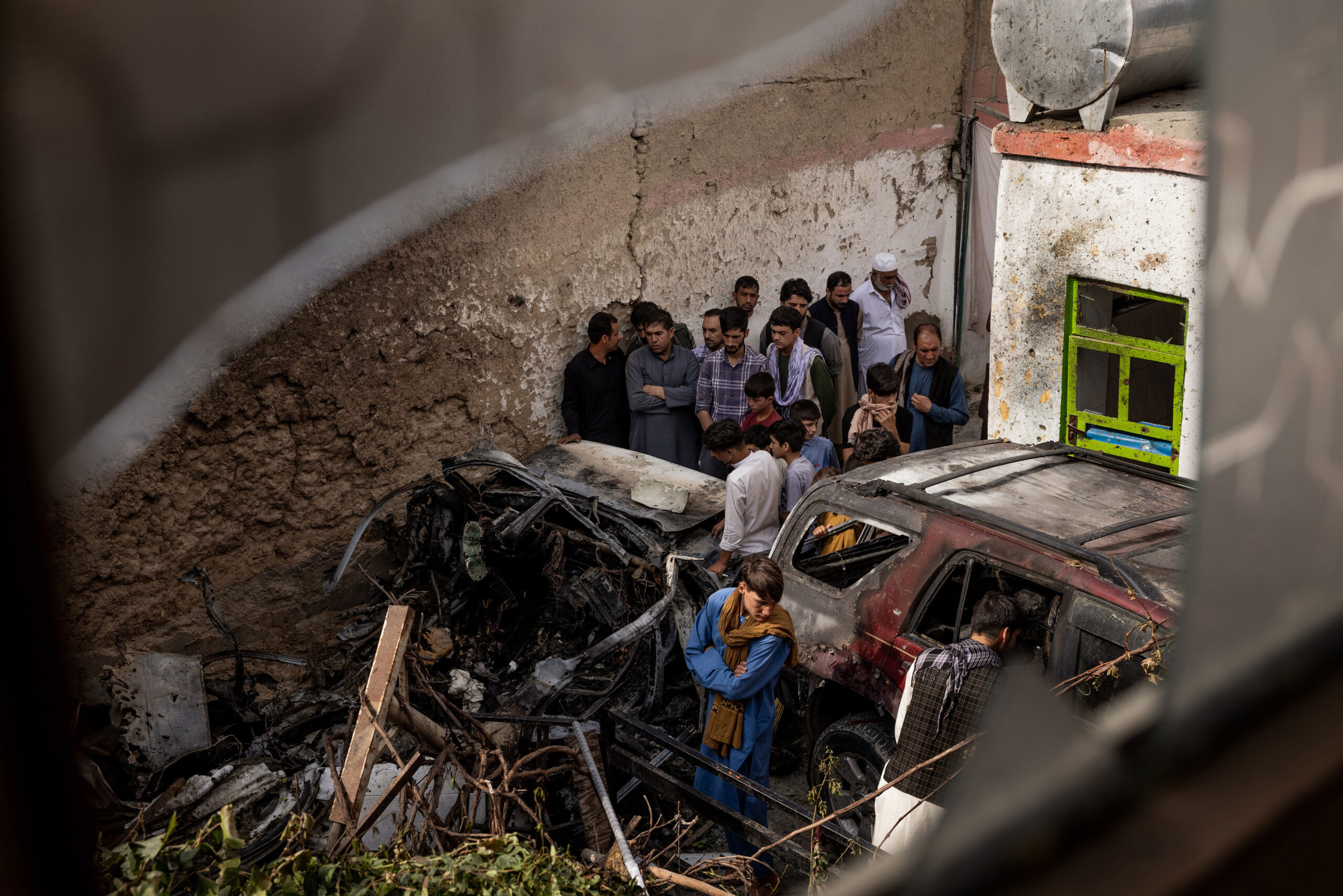 <i>Jim Huylebroek/The New York Times/Redux</i><br/>Relatives and neighbors inspect damage in the cramped courtyard of a house in Kabul