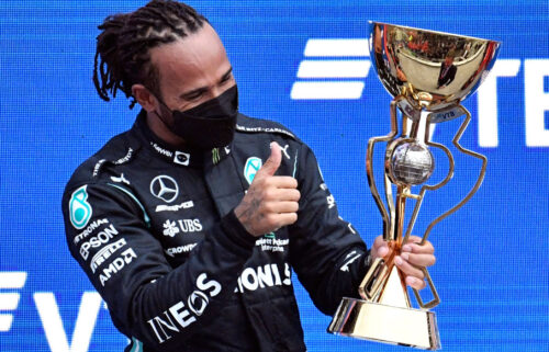 Hamilton celebrates on the podium after winning the Russian Grand Prix.