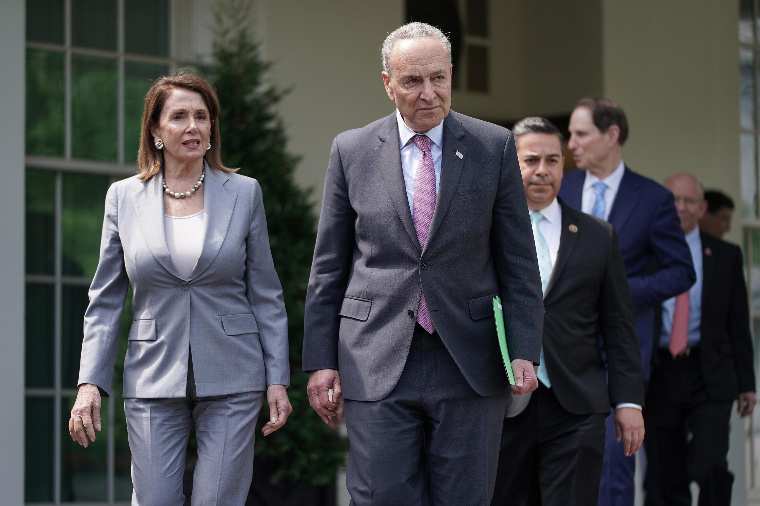 <i>Chip Somodevilla/Getty Images</i><br/>House Speaker Nancy Pelosi and Senate Majority Leader Chuck Schumer are seen here after meeting with other House and Senate Democrats.