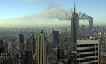 Plumes of smoke pour from the World Trade Center buildings in New York Tuesday