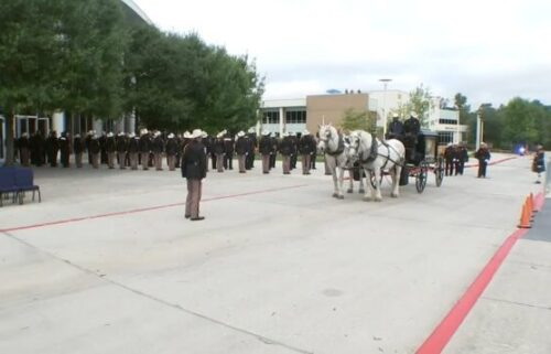 Officers line up in front of a Houston funeral home on October 25 to honor Kareem Atkins