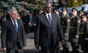 """US Defense Secretary Lloyd Austin (right) on October 19 called on Russia to stop its occupation of Crimea and to halt its """"persistent cyberattacks"""" against the United States. Austin is seen with Ukrainian Defense Minister Andriy Taran in Kiev."""