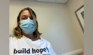 """Anne LaPorte while receiving chemo treatment two weeks ago in her """"build hope"""" shirt from Lung Cancer Resesarch Foundation's Free to Breathe walk."""