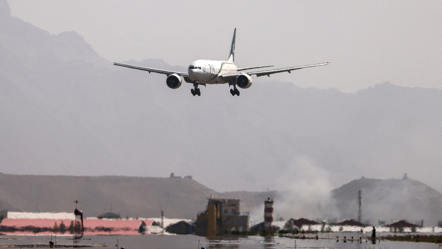 <i>Karim Sahib/AFP/Getty Images</i><br/>Pakistan International Airlines (PIA) announced Thursday that it was suspending flights to Afghanistan due to what it described as unworkable conditions imposed by the Taliban. A Pakistan International Airlines plane is shown landing at Kabul airport on September 13.