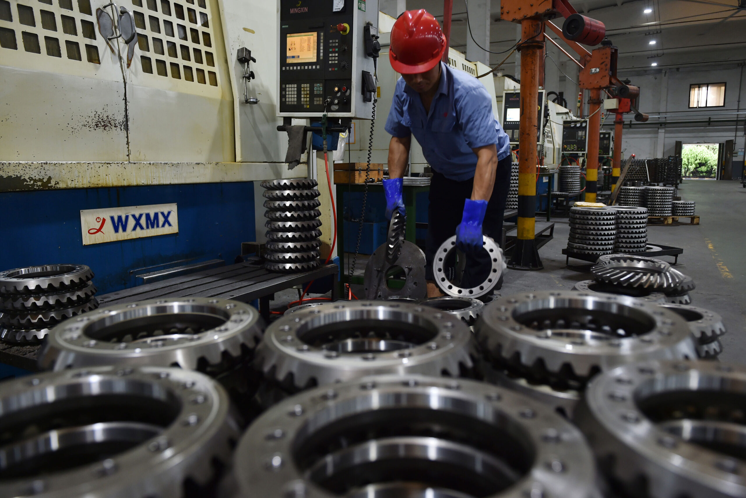 <i>Feature China/Barcroft Media/Getty Images</i><br/>The cost of goods leaving China's factories is surging by the highest rate on record. A worker is shown here in a factory of automotive parts in Taizhou in east China's Jiangsu province Wednesday