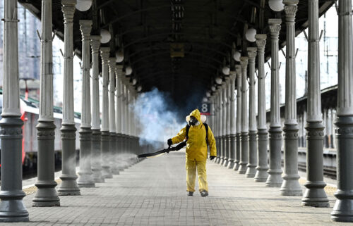 A worker disinfects Moscow's Belorussky railway station on October 20. Moscow will impose a 10-day lockdown from October 28 to November 7 in an effort to curb soaring Covid-19 cases