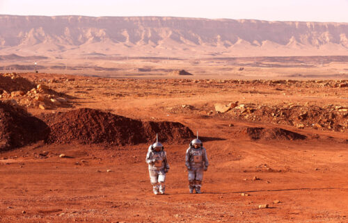 A couple of astronauts from a team from Europe and Israel walk in spacesuits during a training mission for planet Mars at a site that simulates an off-site station at the Ramon Crater in Mitzpe Ramon in Israel's southern Negev desert on October 10.