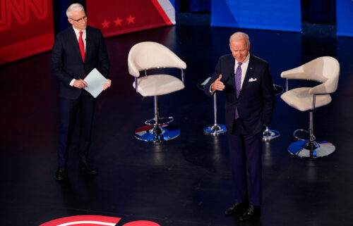 President Joe Biden has for months been circumspect in describing the behind-the-scenes negotiations with Sens. Joe Manchin and Kyrsten Sinema over his sweeping domestic ambitions. He emerged Thursday prepared to spill some of the details.