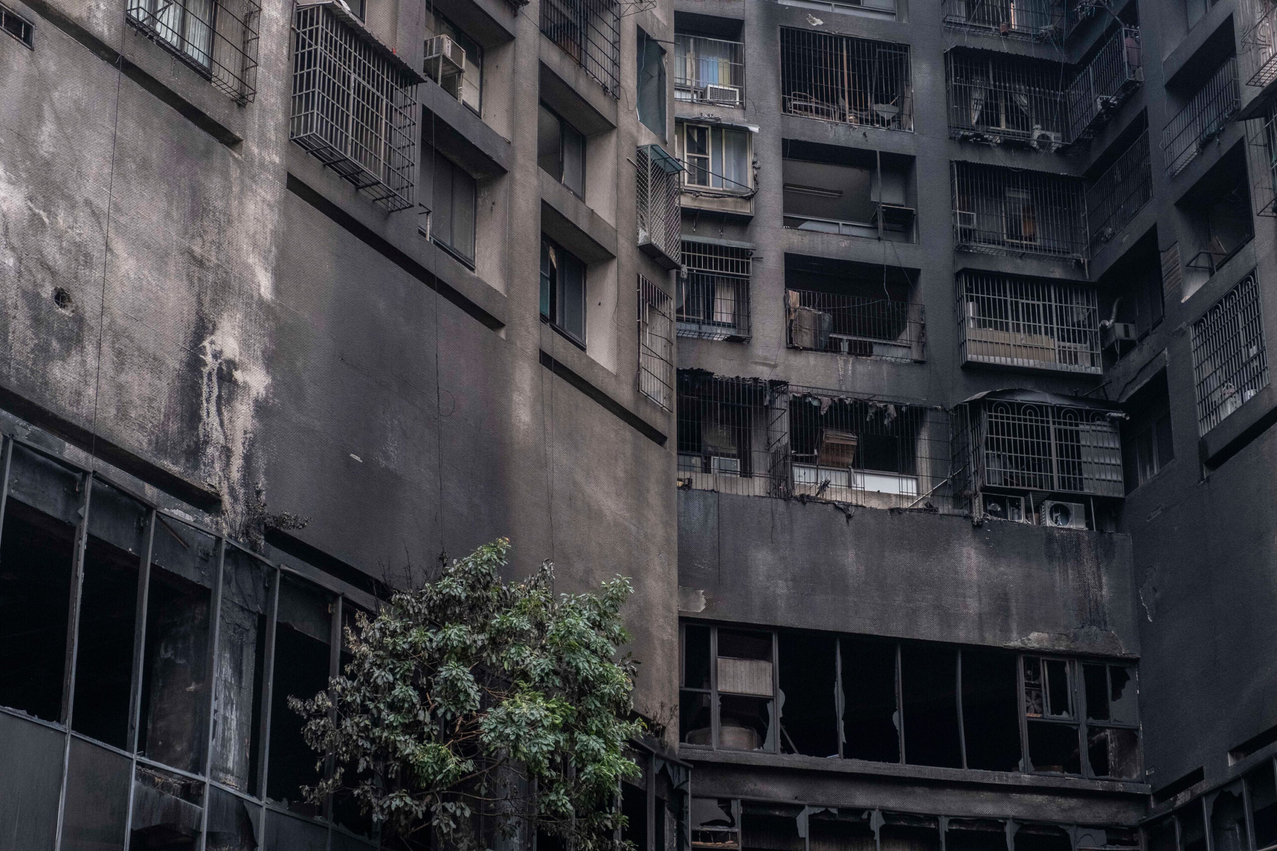 <i>Lam Yik Fei/Getty Images</i><br/>The exterior walls of a residential building stands charred in the wake of a fire on October 14