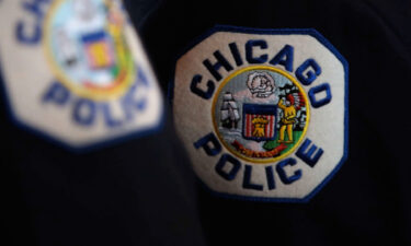 Up to half of Chicago's rank-and-file police officers could be placed on unpaid leave starting Friday because of a dispute between their union and Mayor Lori Lightfoot over a city requirement for officers to disclose their vaccine status.