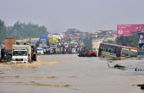 Heavy rains forced the river Kosi in India's Uttar Pradesh state to overflow.
