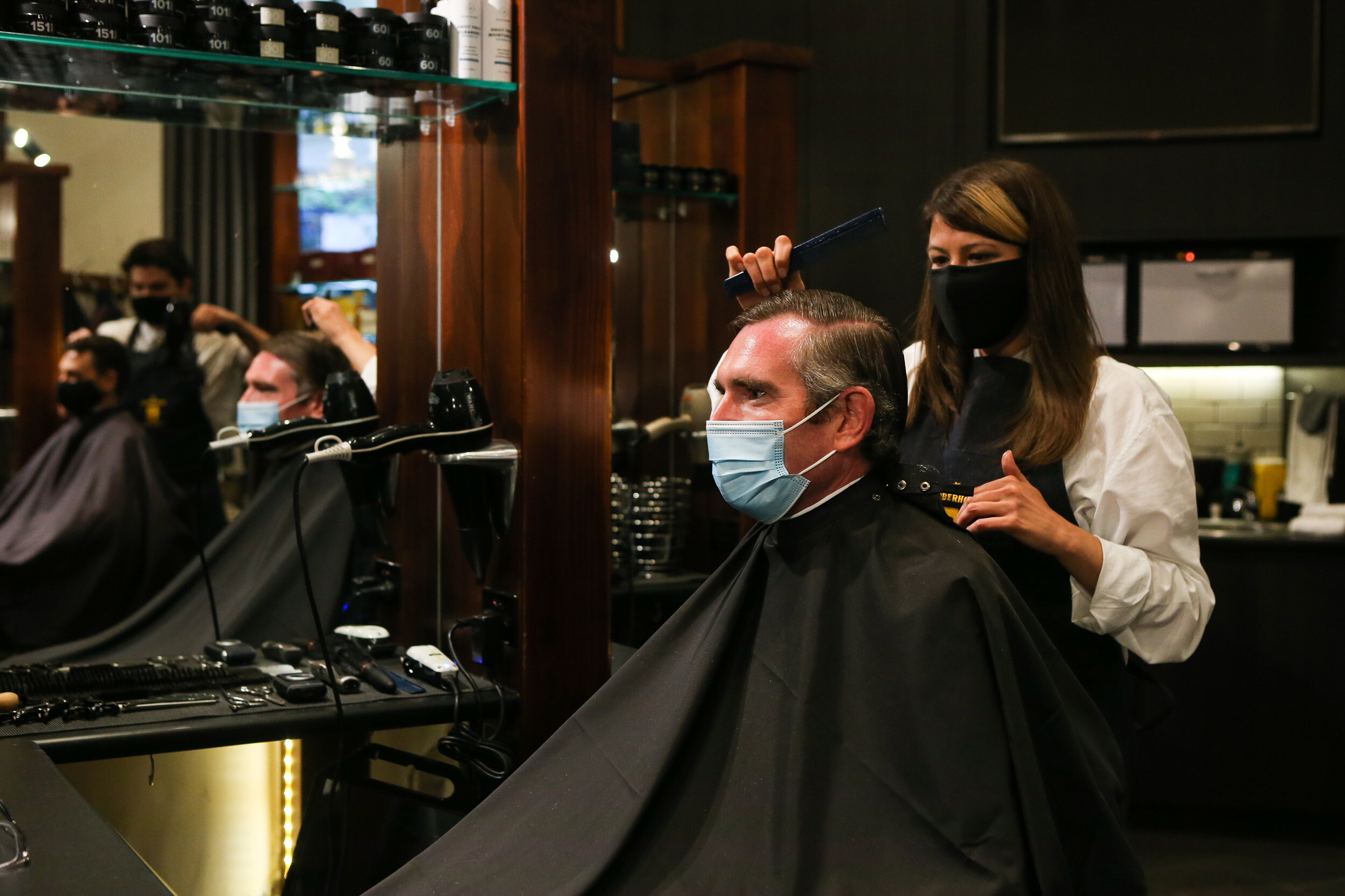 <i>Gaye Gerard/Pool/Getty Images</i><br/>NSW Premier Dominic Perrottet receives a haircut on October 11